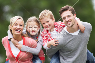 stock-photo-33169982-parents-giving-children-piggybacks-in-countryside